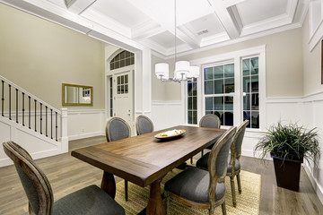 Lovely craftsman style dining room with coffered cealing