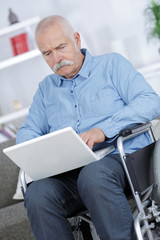 retiree using a laptop