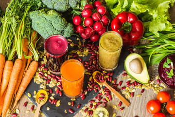 Healthy vegan food. Fresh vegetables on wooden background. Detox diet. Different colorful fresh juices
