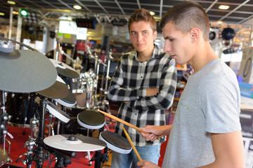 Young man playing electronic drum set