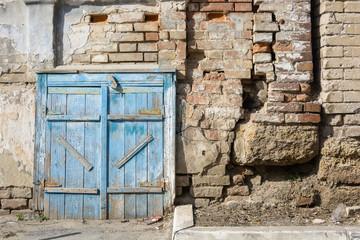 Old barn door painted blue