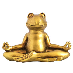 Smiling gold yoga frog meditating in lotus pose. Body, mind and soul balance concept. Isolated on white