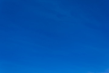 Blue vivid sky. Shot of clear vividly blue sky without clouds.