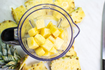 Pineapple slices in a blender