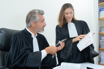 judges reading law book
