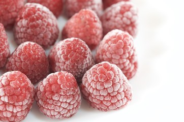 Frozen raspberry on the dish
