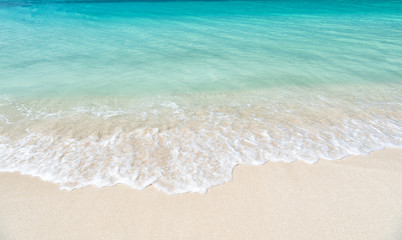 wavy sea, ocean water background on sand coast in Antigua