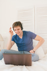 Man listening to music at a laptop