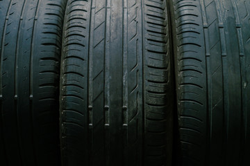 Car tires on the service place. Low light image.