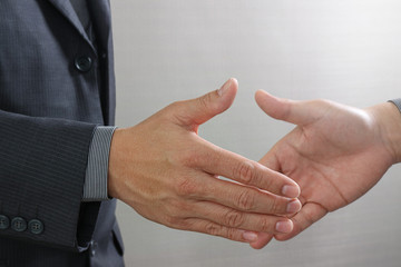 Business partnership meeting concept.photo businessmans handshake. Successful businessmen handshaking after perfect deal.close up