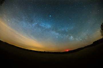 Astro Landscape with the Milky Way as seen from the Odenwald near Bullau in Germany.