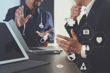 Medical co working concept,Doctor working with smart phone and digital tablet and laptop computer to meeting his team in modern office at hospital