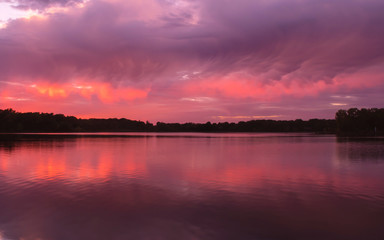Beautiful sunset over a lake in summer time