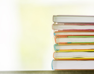 pile of books on natural background