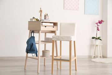 Modern stand-up desk and chair in living room