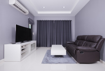 residential interior of modern living room with sofa and TV