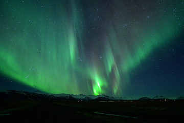 Spectacular auroral display at night over mountian ,spectacular auroral and star at night ,Iceland