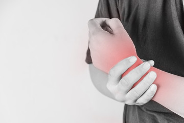 wrist injury in humans .wrist pain,joint pains people medical, mono tone highlight at wrist