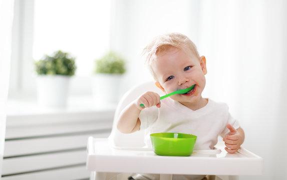 Happy baby eating himself
