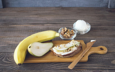 Set of products for making sandwiches from bread and ripe fruit pear banana