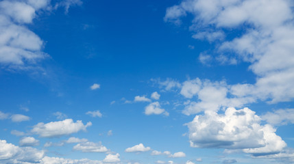 Heaven, clouds flying against blue sky.