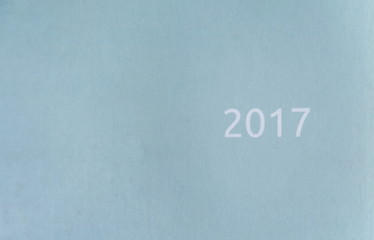 pale blue paper texture written 2017 for background.