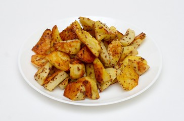 fried potato with spiced on white plate isolated