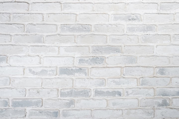 Abstract horizontal white background of a brick wall.
