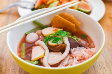 Closeup pink seafood flat noodles (Yen ta fo)