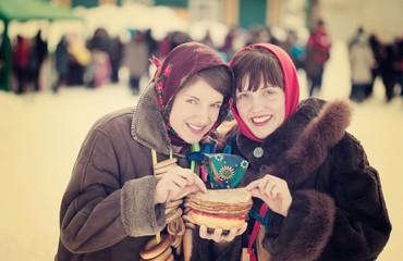 Women eating pancake during  Pancake Week