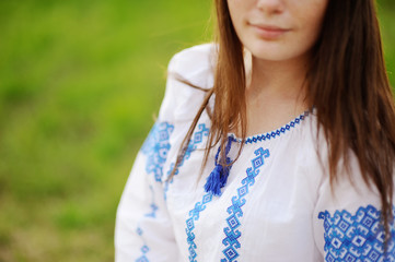 portrait of beautiful girl in Ukrainian national dress on the nature background