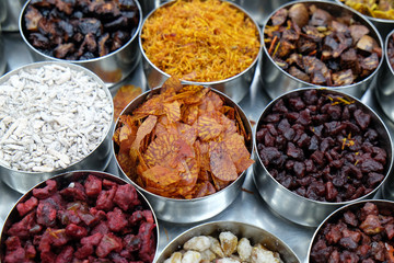 Different spices and herbs in metal bowls on a street market in Kolkata, West Bengal, India