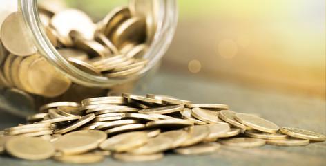 Website banner of golden coins closeup - money savings concept