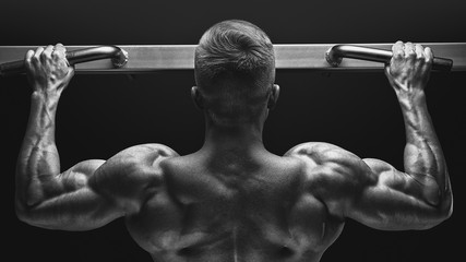Close Up Photo Of Attractive Muscular Bodybuilder Guy Doing Pullups In Gym Fitness Man