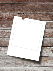 Blank square photo frame on weathered wooden background