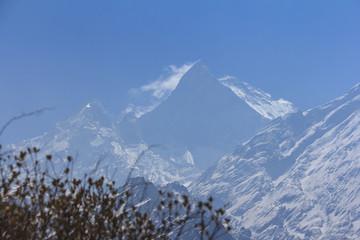 Himalaya Machapuchare mountain peak with blue sky, Nepal