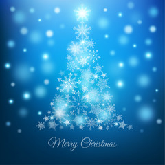 Magic Christmas tree with snowflakes on blue background