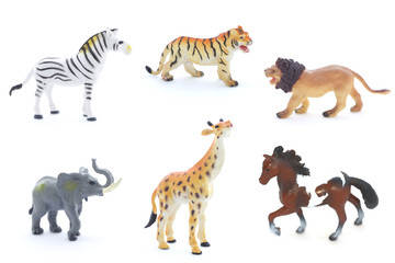 Collage of toy animals isolated on white background