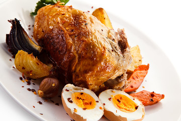 Roast chicken meat with potatoes and boiled egg