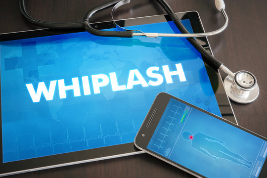 Whiplash (neurological disorder) diagnosis medical concept on tablet screen with stethoscope