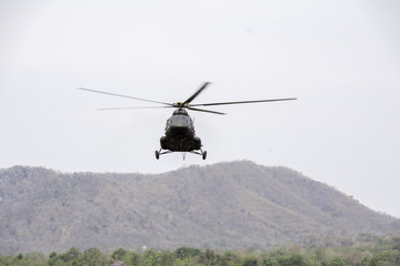 Helicopter in flight. Fly over the mountain and  sky