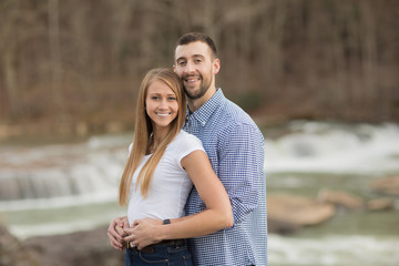 engaged couple in front of water fall