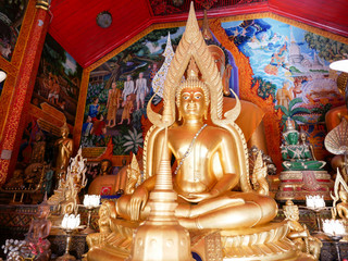 Buddha statues inside the Wat Phra That Doi Kham (Temple of the Golden Mountain) in Chiang Mai, Thailand