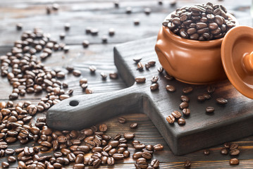 Rustic pot of coffee beans