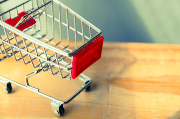 side view of Shopping cart on wood table