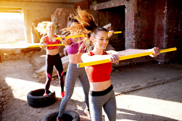 Attractive females having hard training outside the gym working out exercising.