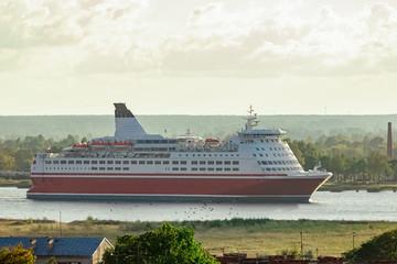 Red cruise ship. Passenger ferry sailing around the Riga city