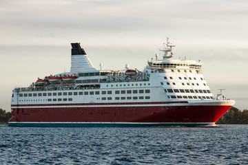 Red cruise liner. Passenger ferry sailing from Riga to Stockholm