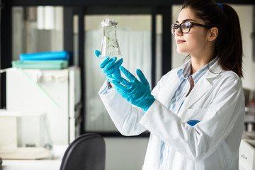 Young female geneticist looking in plant samples.Agricultural laboratory.
