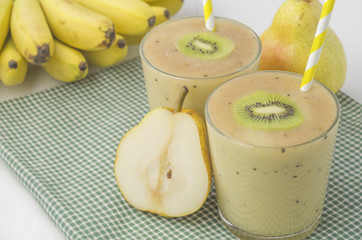 Banana smoothie with kiwi and pear. Picture with space for text or logo